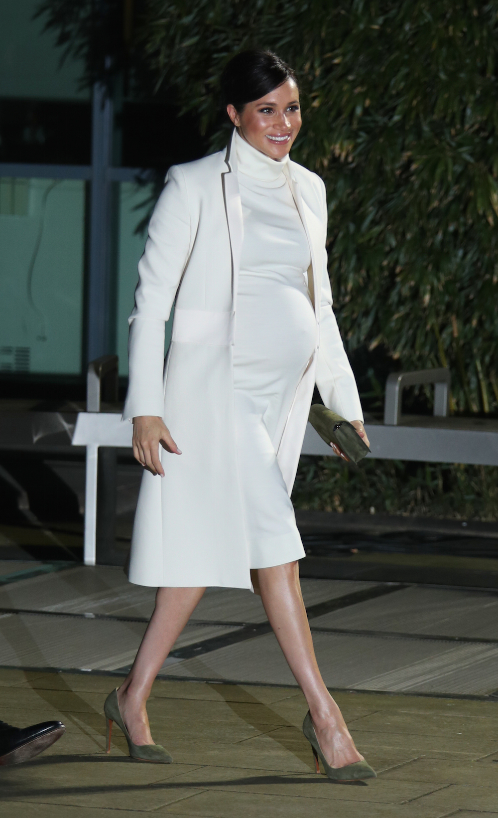 Meghan has worn the cream Amanda Wakeley 'Crombie' coat several times before