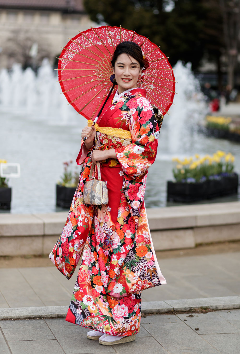 Traditional kimonos are still worn today – as seen on this woman in Tokyo
