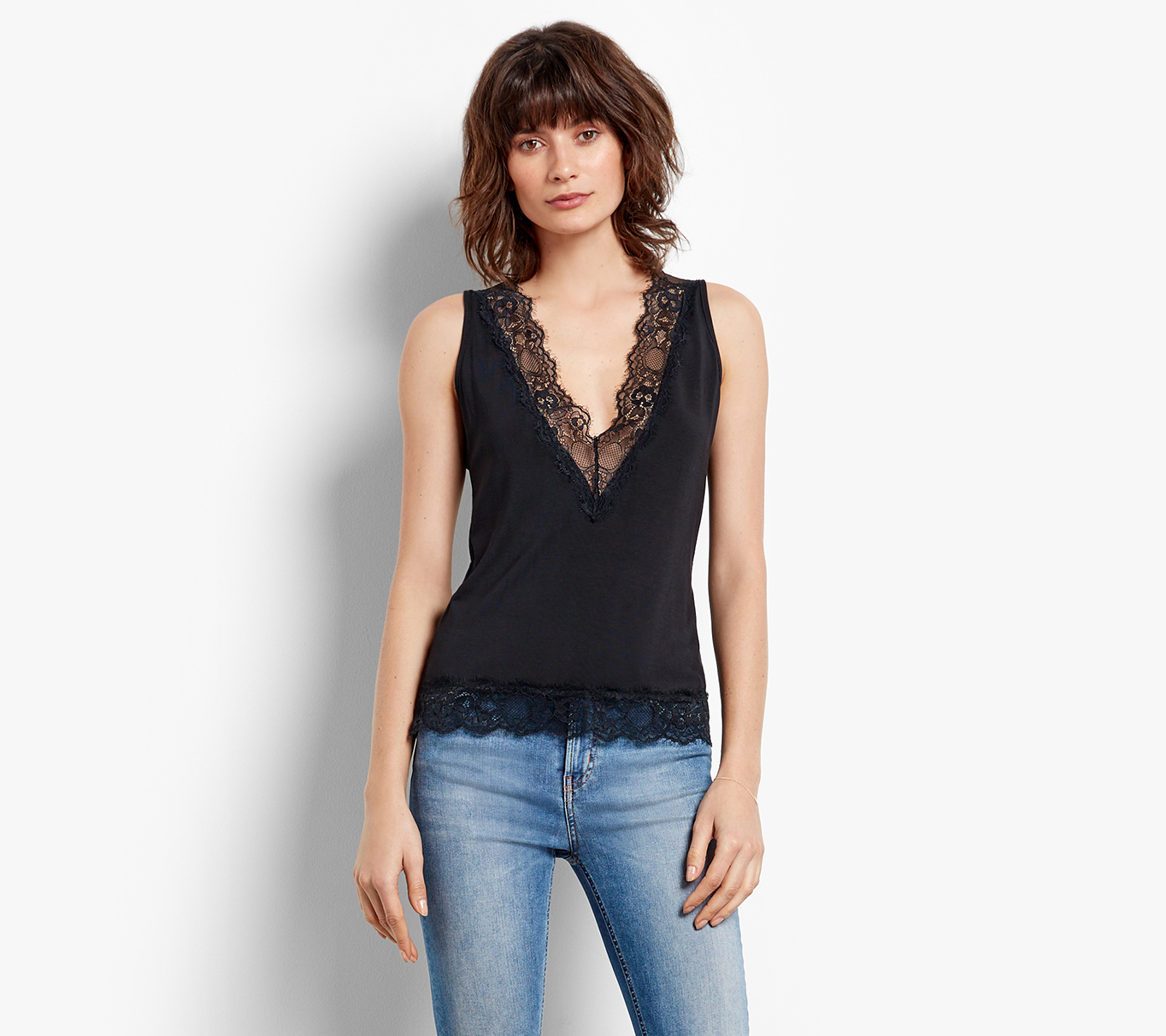 Hush Black Peek A Boo Top, £35/AED156.85; Holly Cropped Jeans, £65/AED291.29