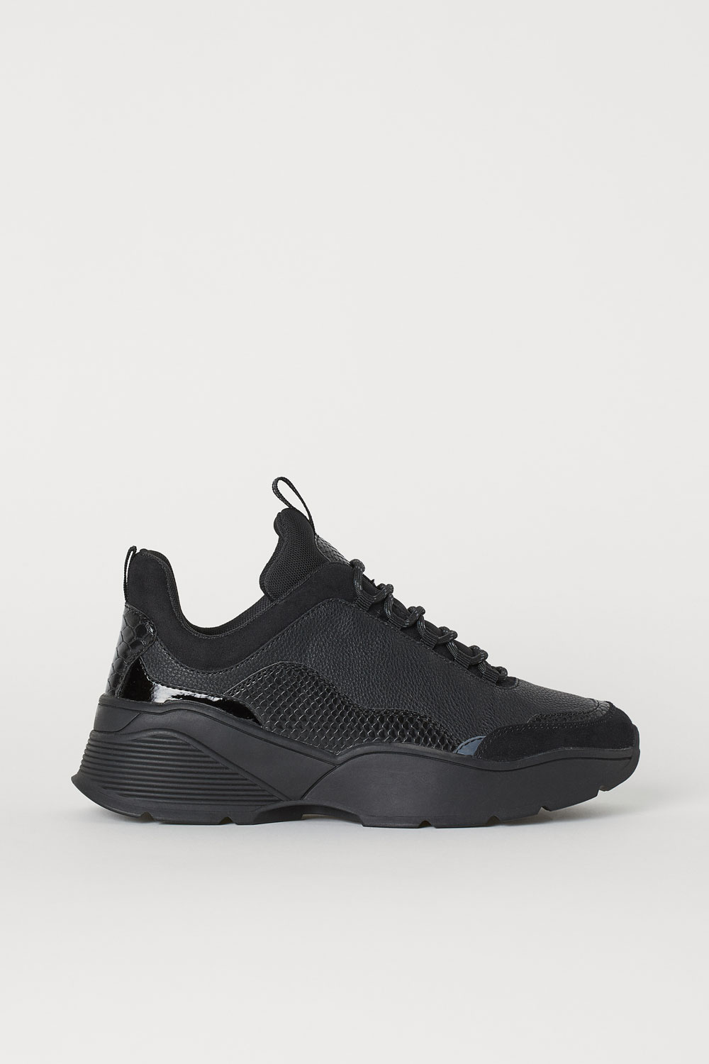 H&M black trainers, £29.99/AED132.49