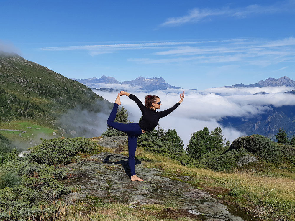 A yoga session on top of the mountain at Cabane Brunet
