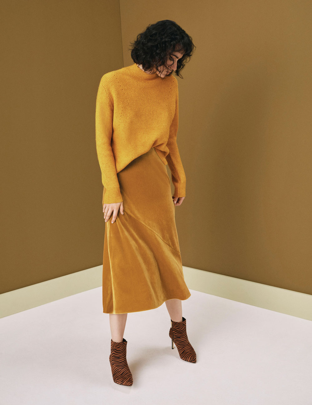 Oasis Ochre Raakel Ribbed Jumper, £40; Mid Yellow Bias Cut Skirt, £32; Tiger Boots, £45/AED203.12