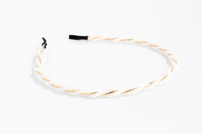 White faux pearl detailed headband on SIVVI