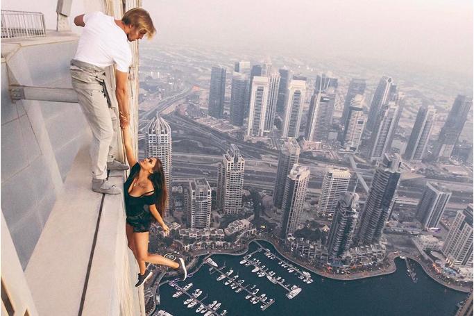 model hangs from dubai tower